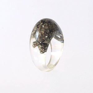 Ring of mineral pyrite and resin