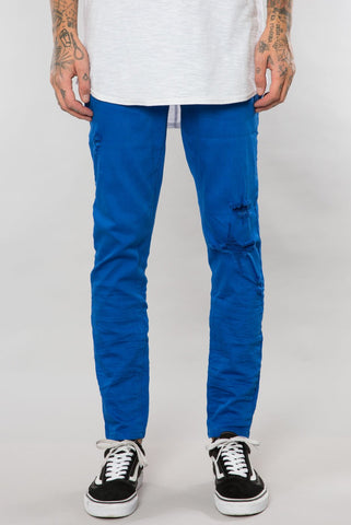 COBALT BLUE DESTRUCTED DENIM SLIM TAPERED PANT