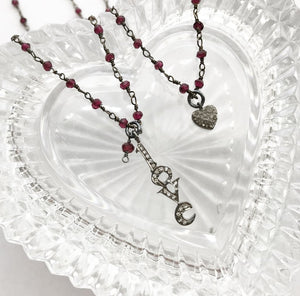 GARNET & WHITE TOPAZ LOVE NECKLACE