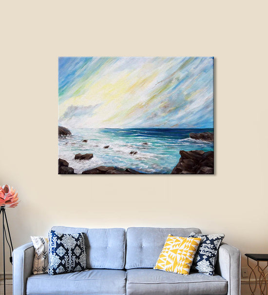Seaside Blues Painting by Seby Augustine Hanging on the Wall above the Sofa