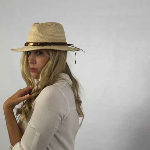 light paper straw fedora style hat with feather band