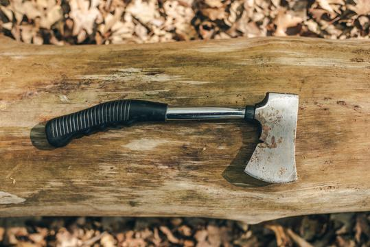 camping hatchet on wood