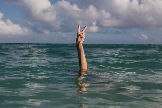 peace sign over water