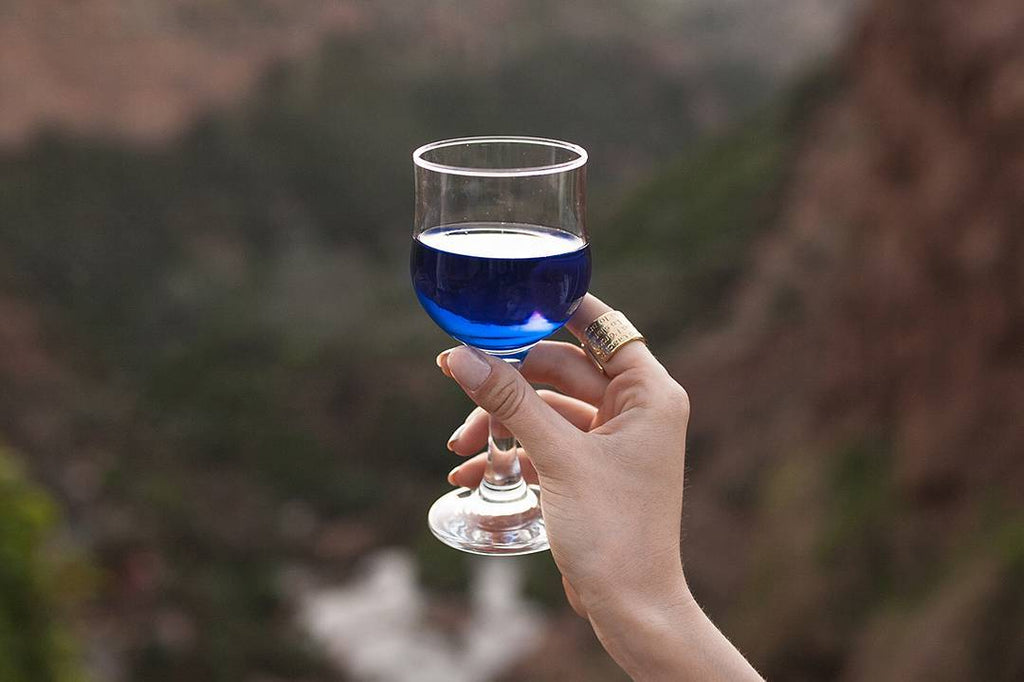 a glass of blue wine