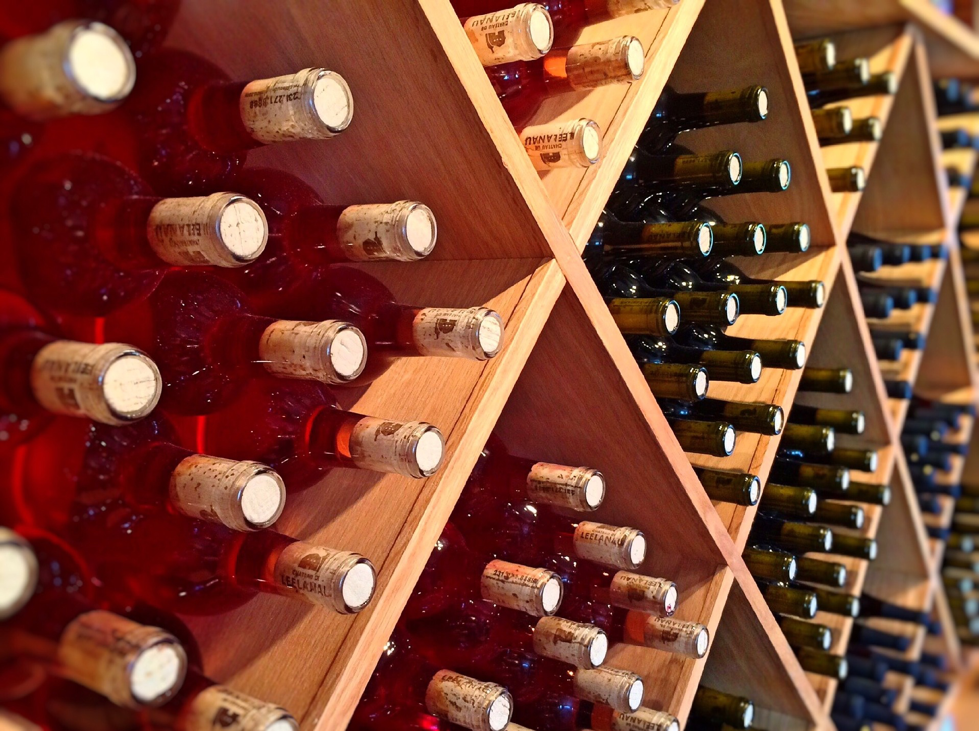 wine bottles being stored in a wine cellar