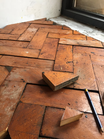reclaimed parquet floor work surface