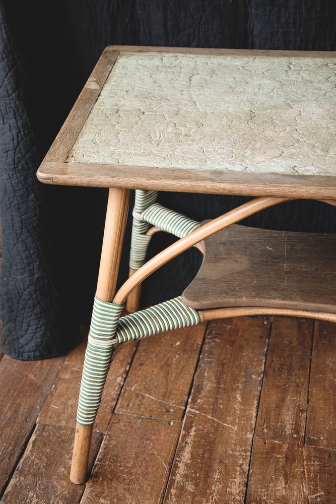 Vintage bamboo and leather table on wooden floor