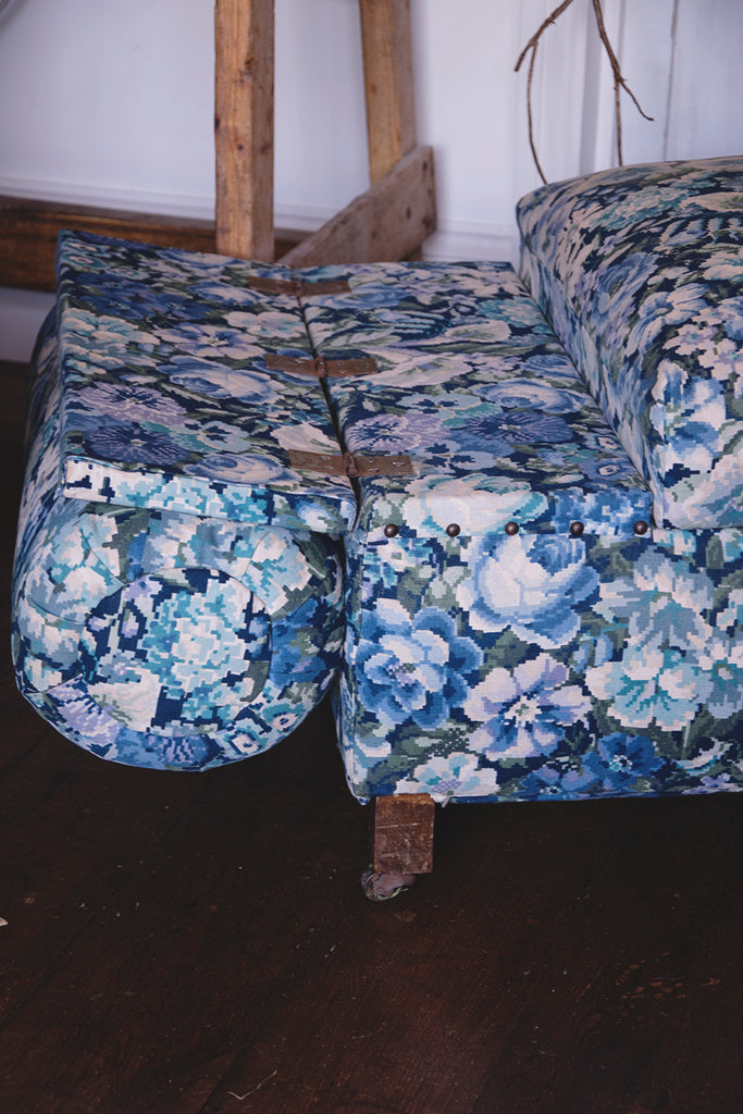 Drop down arm on Upholstered Antique Ottoman in Blue and white fabric. Dig Haushizzle Cassie Nicholas Bristol. Antique Shop