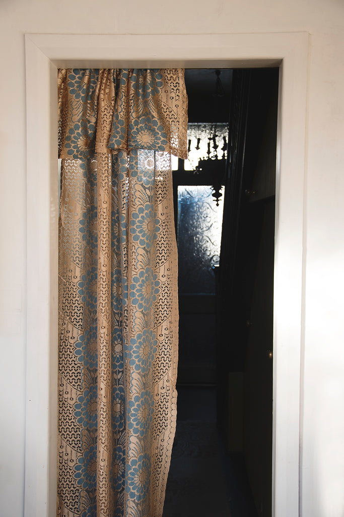Vintage lace door curtain used in interior design. Cassie Nicholas Studios Bristol