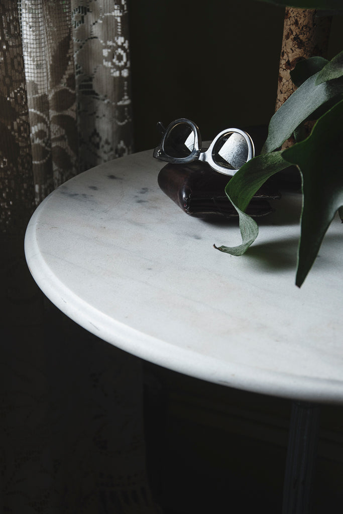 Marble topped round table