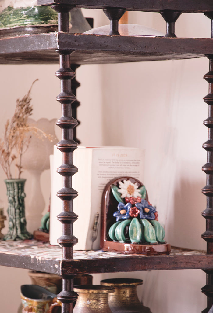 Vintage ceramic bookends on antique shelving.