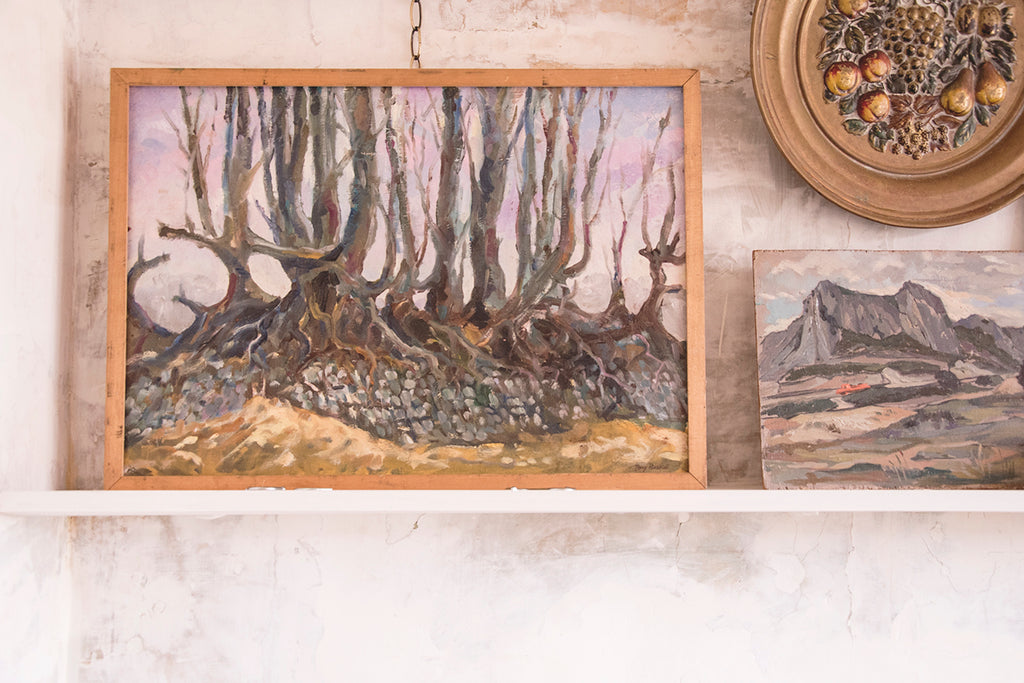 Framed wooded landscape painting