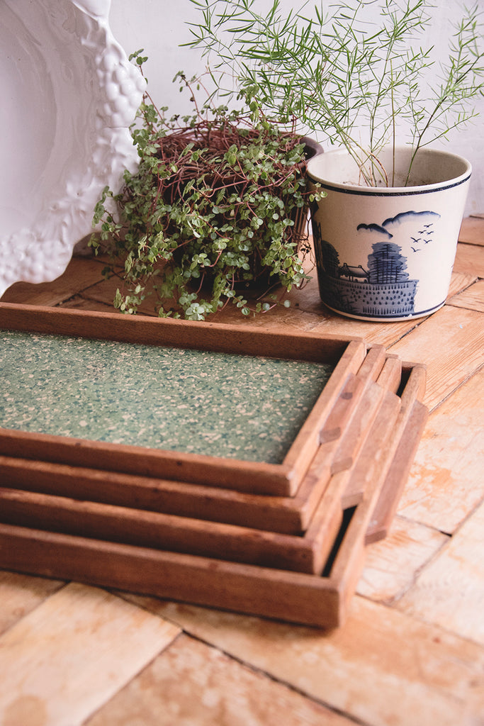 Set of four handmade wooden trays.