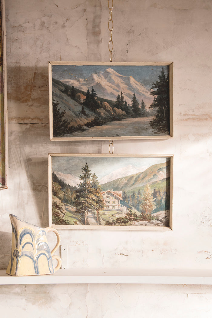 A pair of framed landscapes