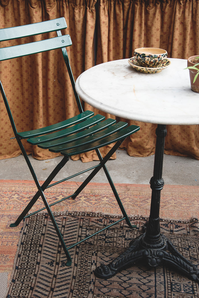 Circular marble topped bistro table