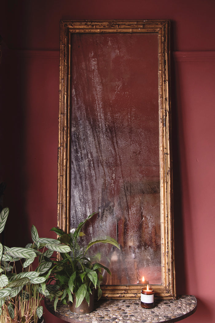 Antique framed mirror with bamboo detailing.