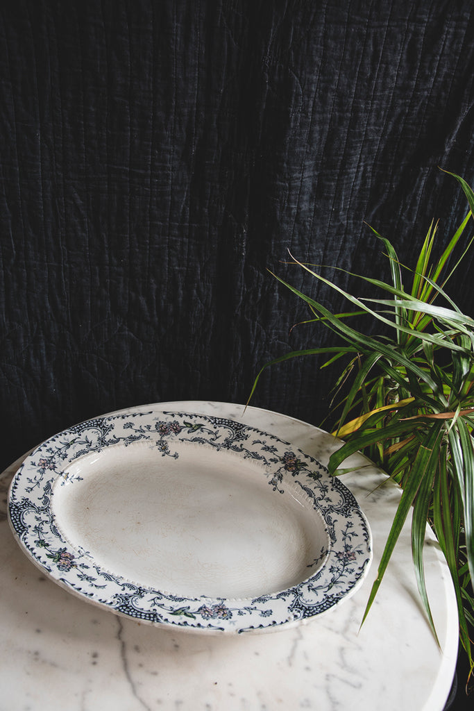 A white platter with blue detailing with hints of green and pinks. Interior design Bristol
