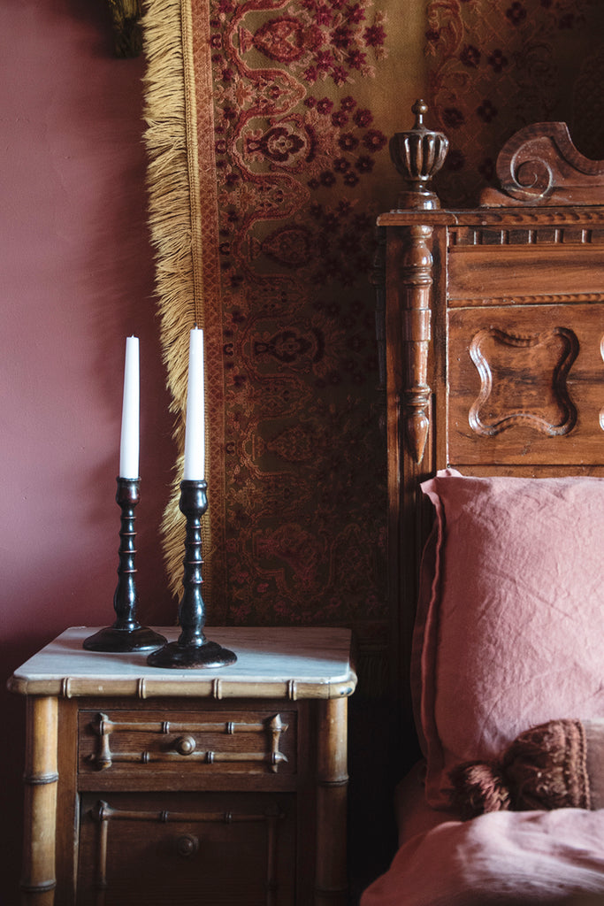 A Pair of Antique Wooden Candlesticks