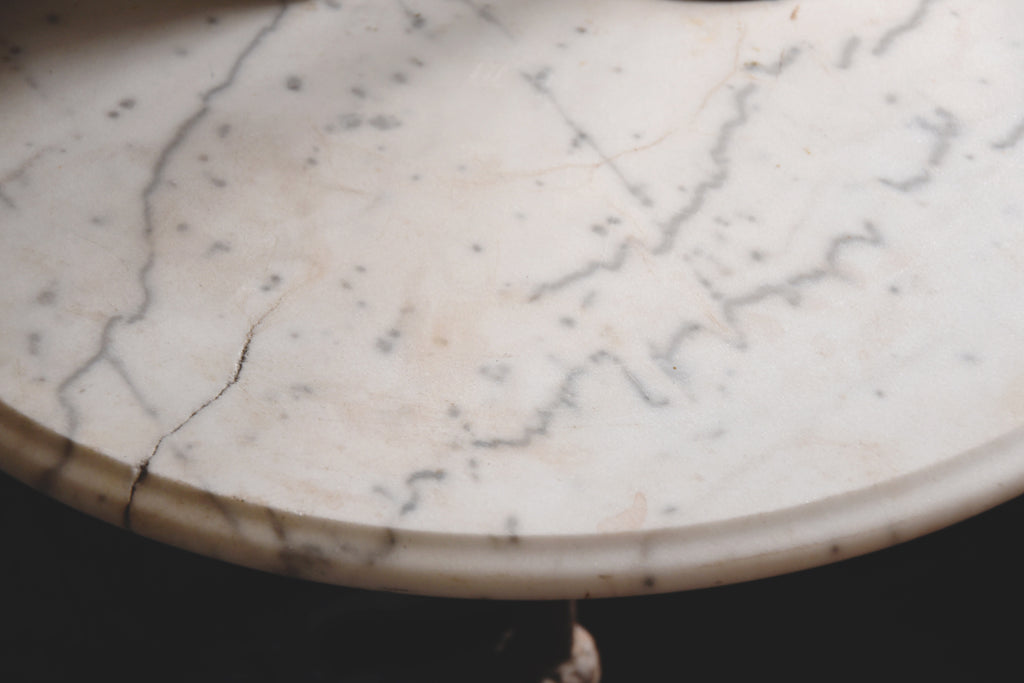 Round vintage marble garden table. Patina worn rustic interior design Bristol
