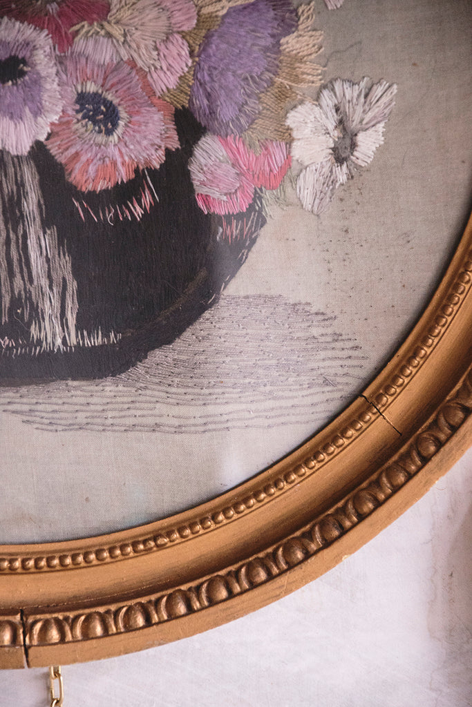 Antique embroidery in original gold circular frame.