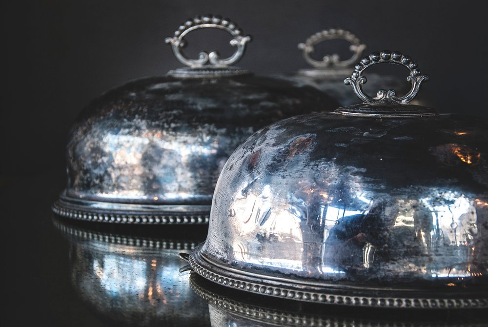 set of three silver plated vintage food domes. tarnished silver patina. Decorative styling Bristol