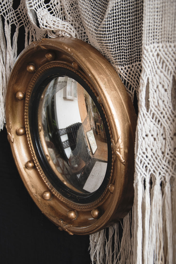 Side profile of an antique convex mirror. Decorative antiques and interior design Bristol. Cassie