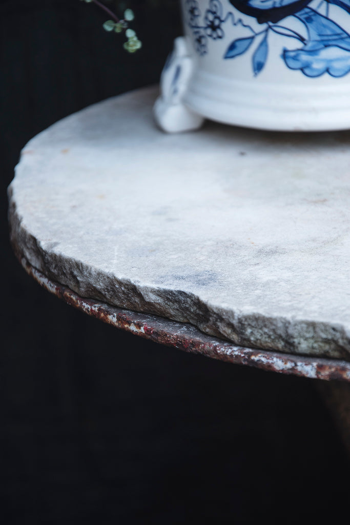 Rustic antique stone topped table