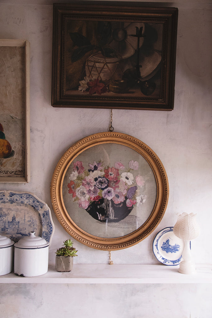 Antique embroidery in original gold circular frame. Product styling and photography Bristol.