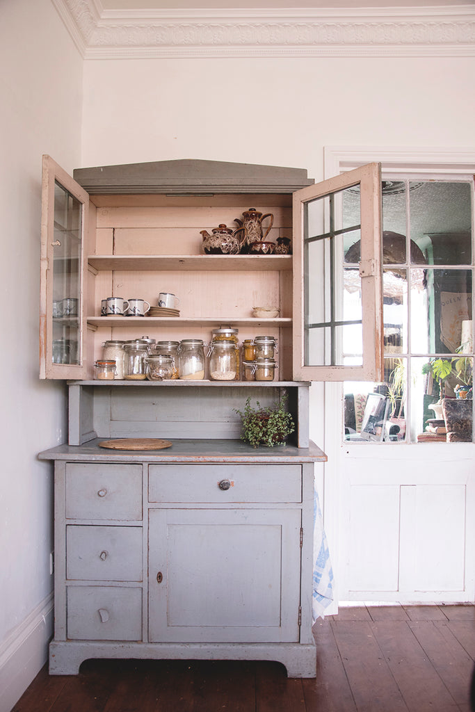 Large vintage dresser with original glass doors and blue paint. Interior stylist Cassie Nicholas