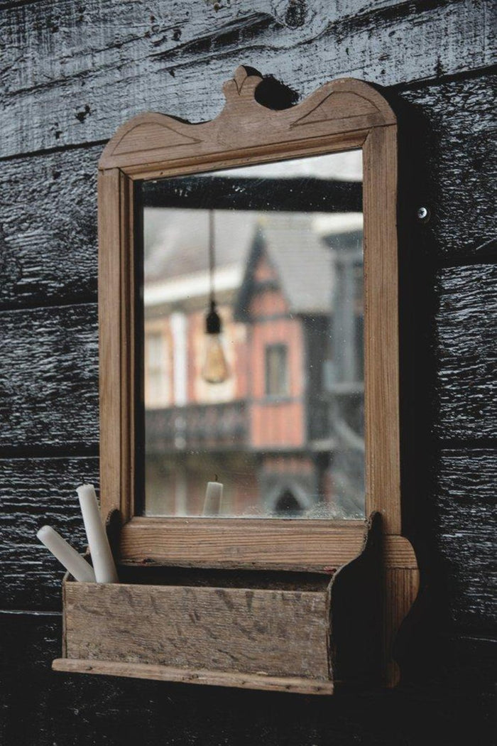 Vintage wooden mirror with shelf. Decorative vintage interiors Bristol