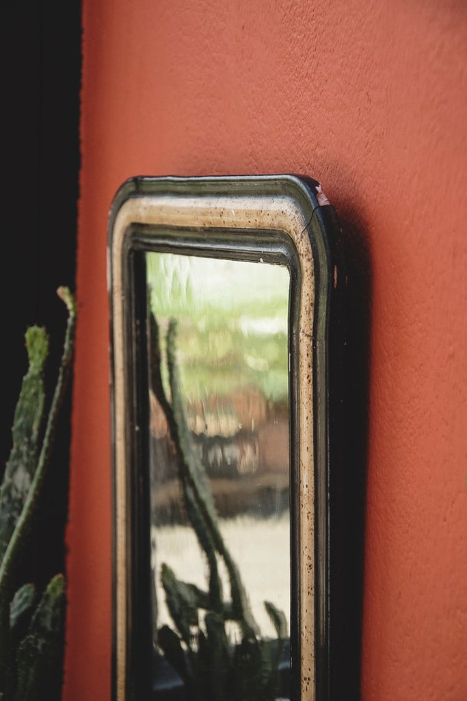 antique mirror with original black and faux bone frame. Interior design and rustic decor Bristol