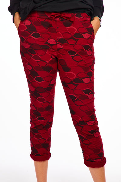 Magical stretch trousers -Autumn print red