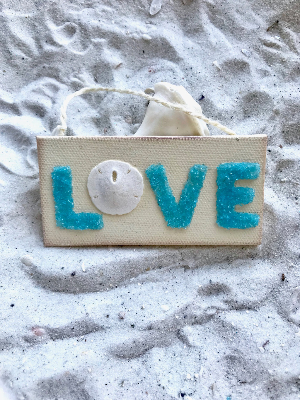 "Love Sign Made with Aqua Crushed Glass & Sand Dollar ""O"""