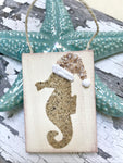 T1551 Sand seahorse with Shell Santa hat
