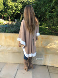 Stylish caramel knit with winter white faux fur trim