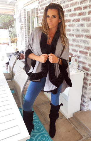 Grey knit poncho with black faux fur trim