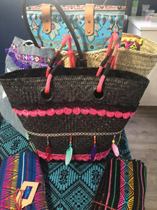 Hand woven black beach basket with pink rope handle