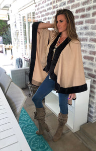 Beige knit poncho with black faux fur trim