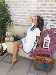 White chiffon kaftan with teal pom pom trim