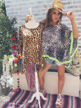 Leopard print poncho style top with lime green trim