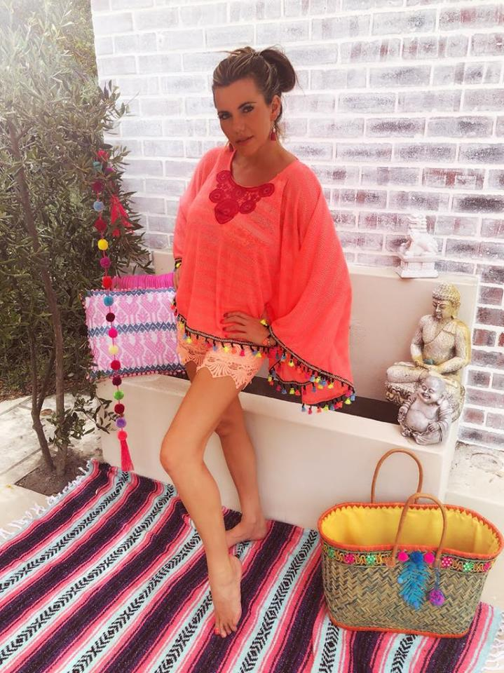 Bright Coral Poncho style top with tassel trim
