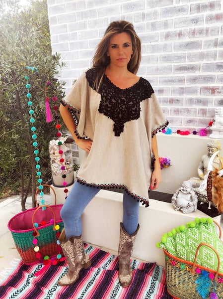 Beige Poncho with black lace insert and pom trim
