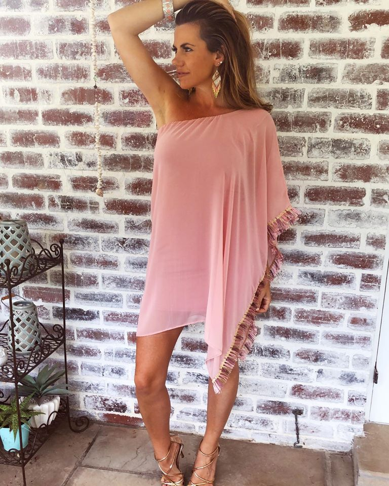 A beautiful dusty pink off shoulder dress with tassel detail