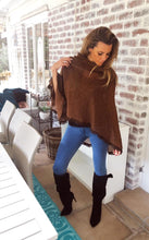 Lightweight brown knit poncho with suede tassel