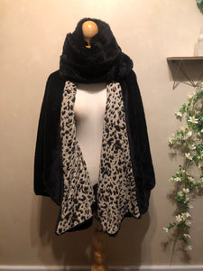 Reversible faux fur and leopard knit poncho
