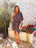 A gorgeous floral off shoulder dress