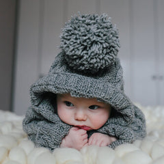 baby in knitted clothes