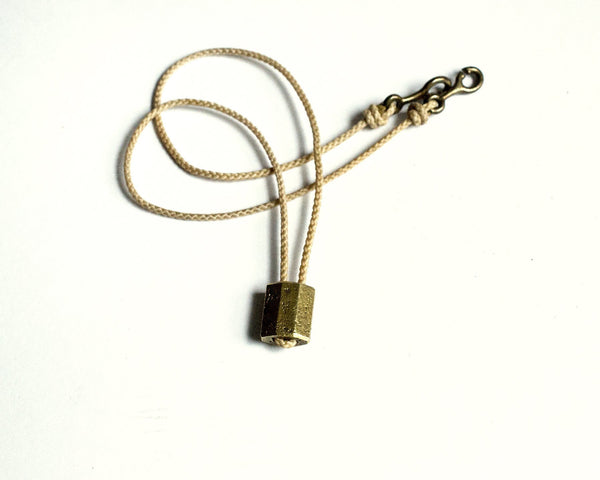 Token Necklace 1, Brass