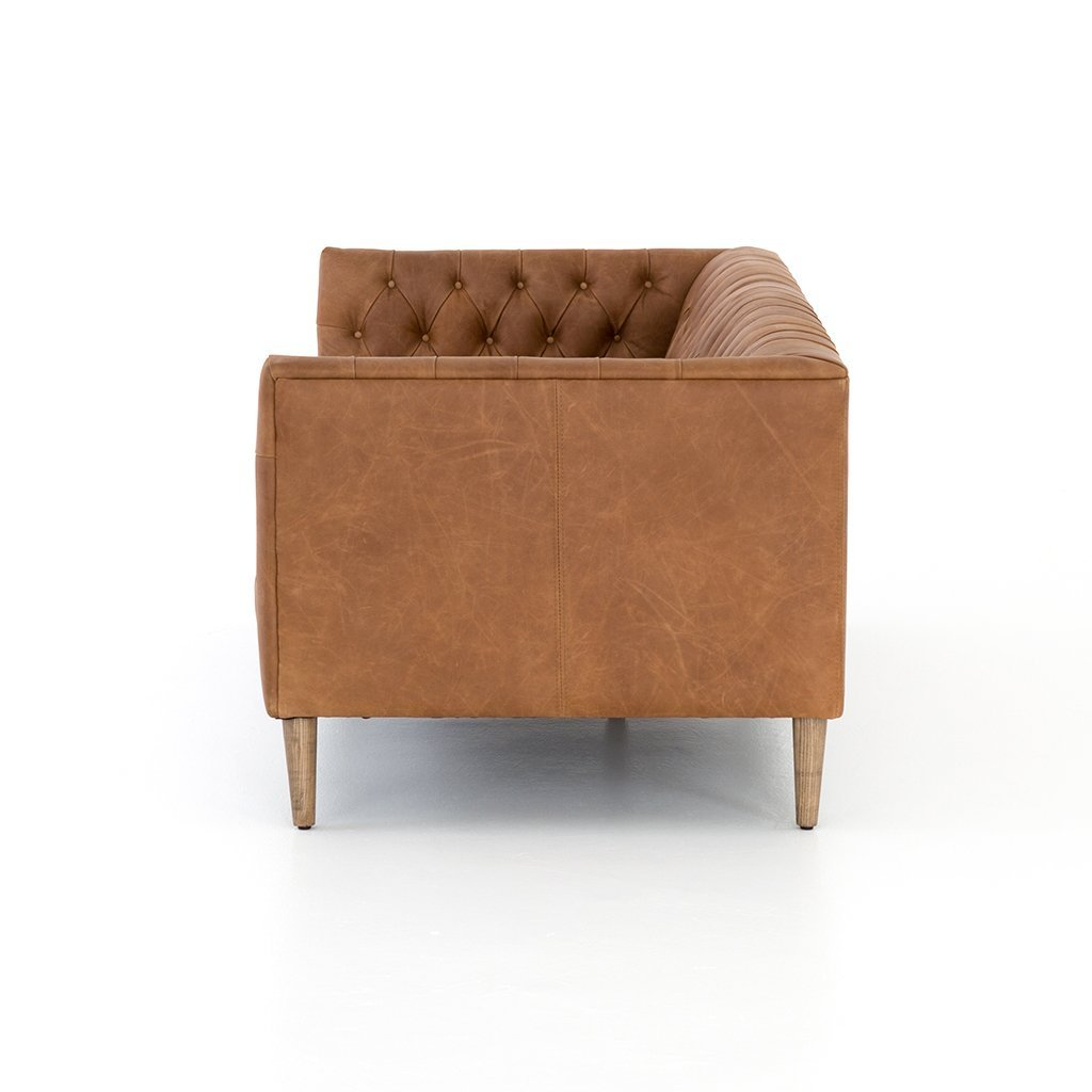 high leg brown leather sofa