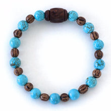 Throat chakra communication enhancer natural spirit warrior crystal bracelet with turquoise and palm wood.